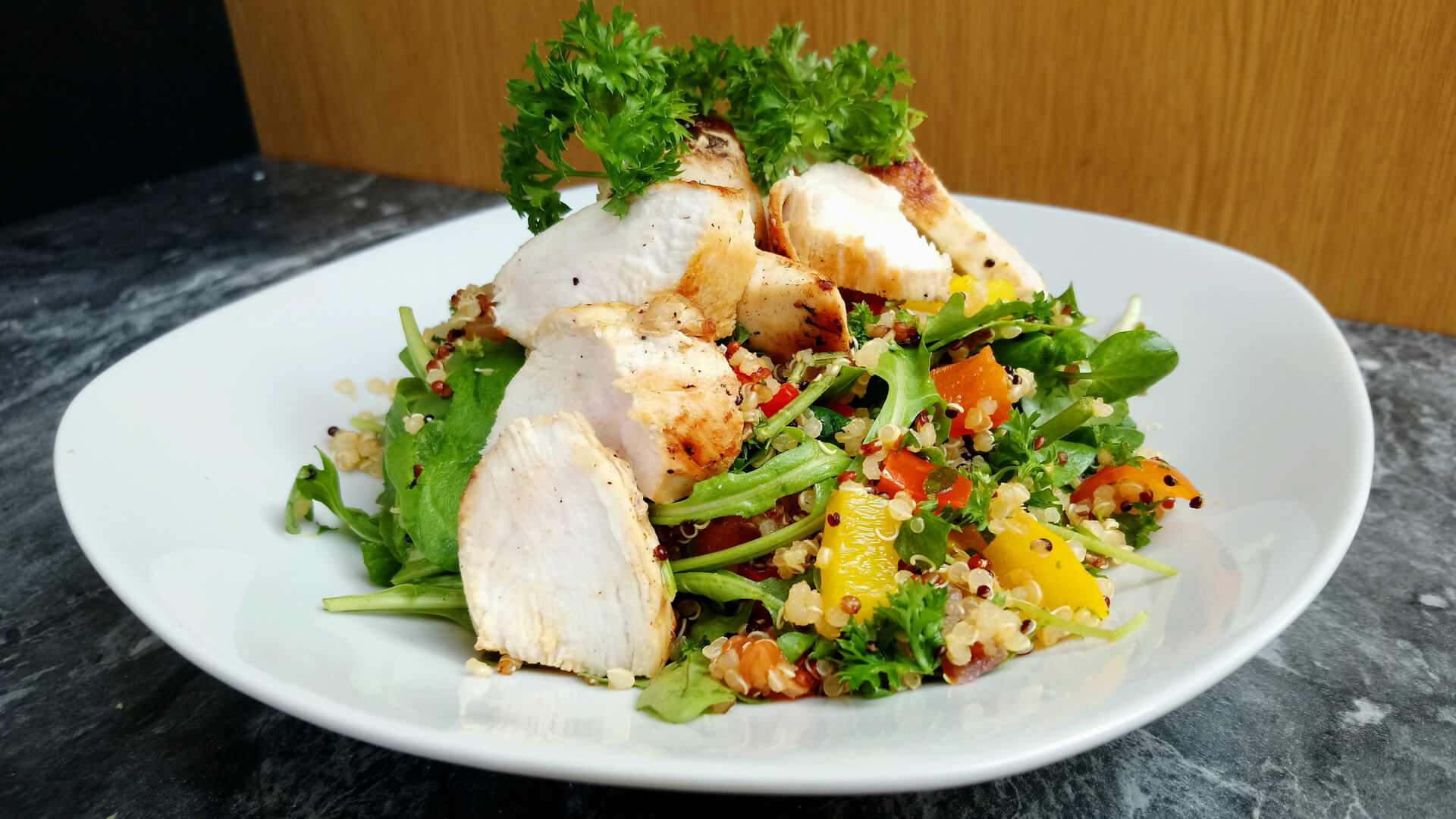Quinoa salad with pan-fried chicken