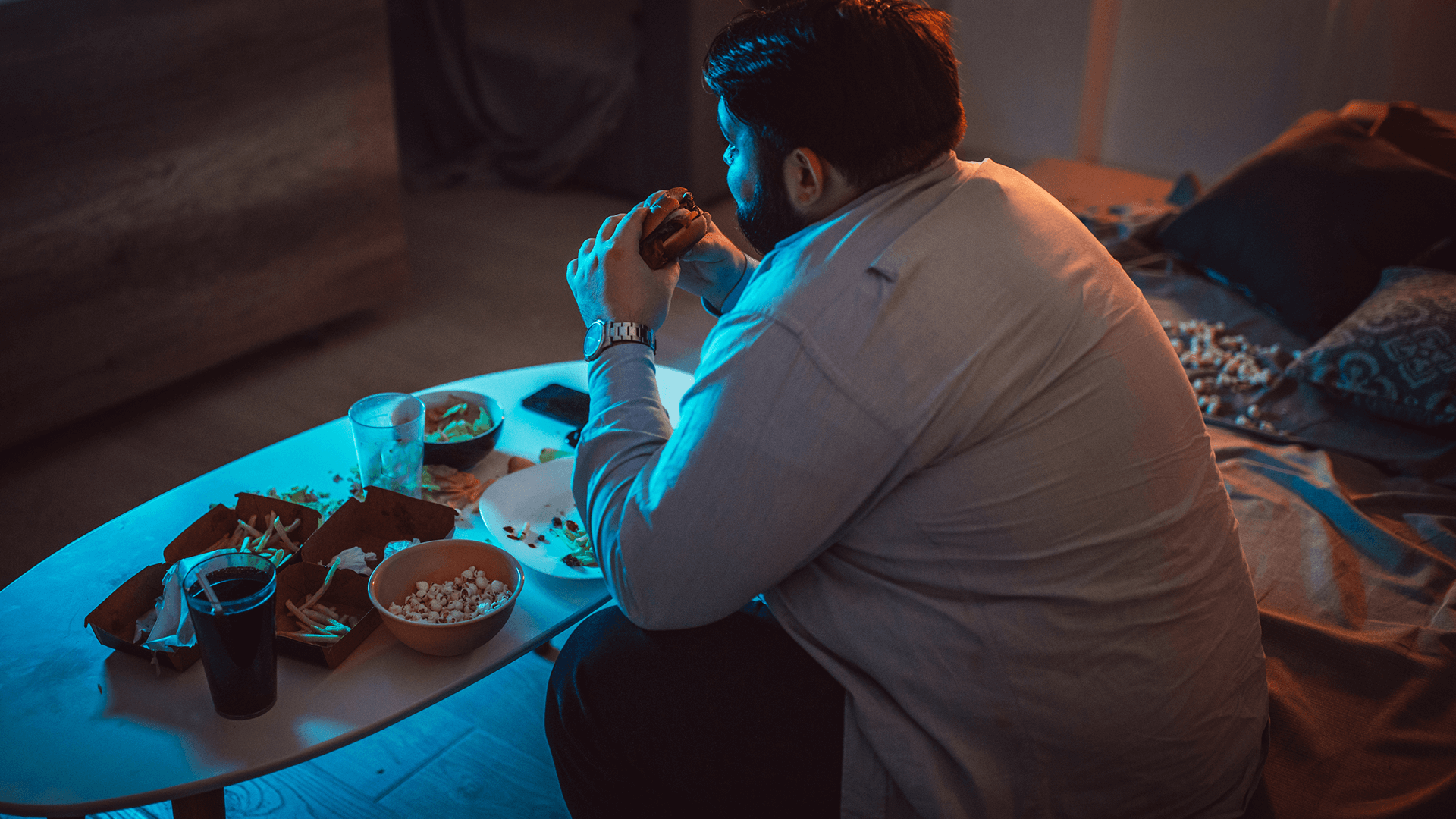 Man eating late night meal
